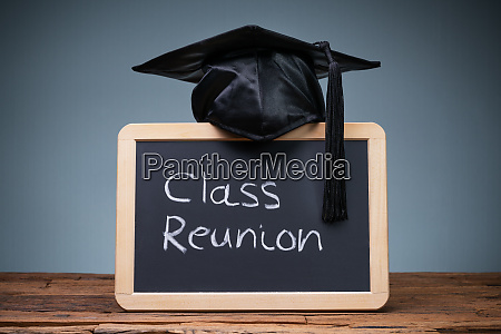 graduation hat over the slate with