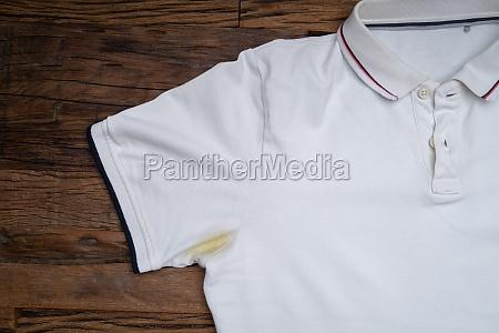 yellow stain under armpit on white