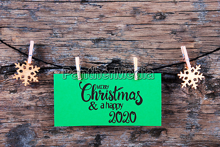 green label wooden background rope merry