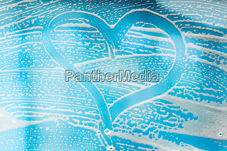 heart shape on abstract soap suds