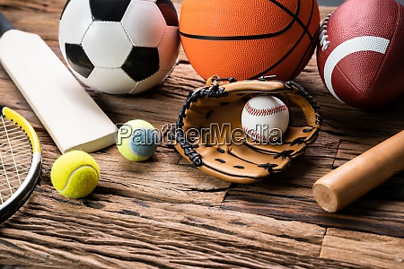 variety of sport accessories on wooden