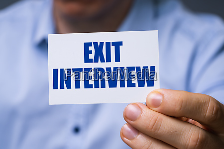 man showing exit interview card