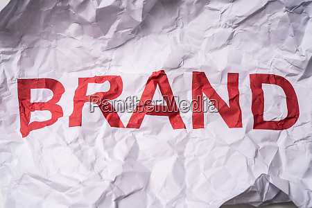 wrinkled white paper with text brand