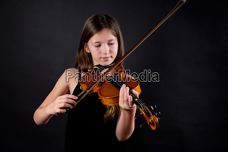 young professional violinist playing and exercising