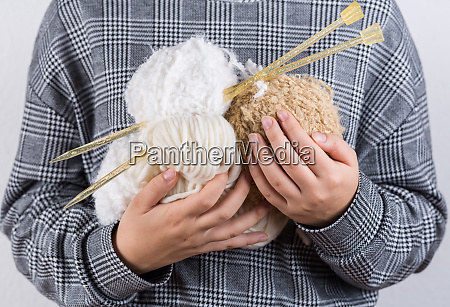 detail of hands holding wool for