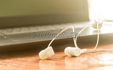close up of headphones ear plugs