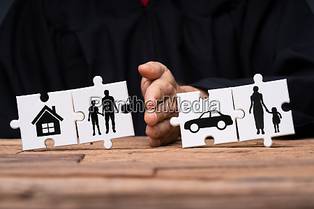 puzzle showing family separation with property
