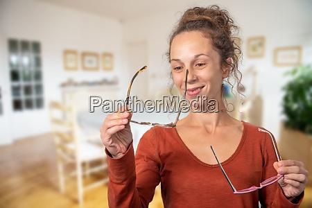 cheerful trendy girl having trouble choosing