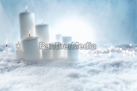 candles decoration in snow
