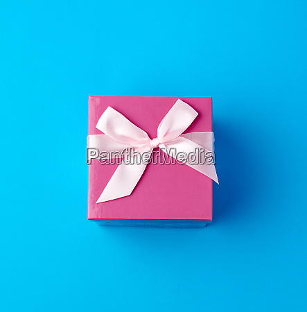 closed pink cardboard box with a