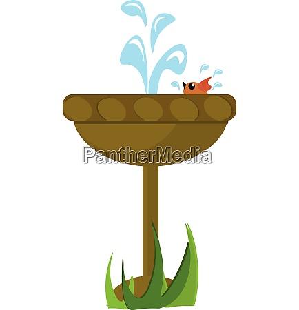 image of bird bathing in fountain