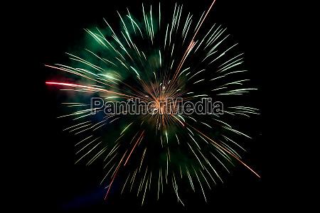 center green orange sparkling fireworks background
