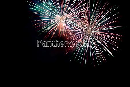 green red sparkling fireworks background on