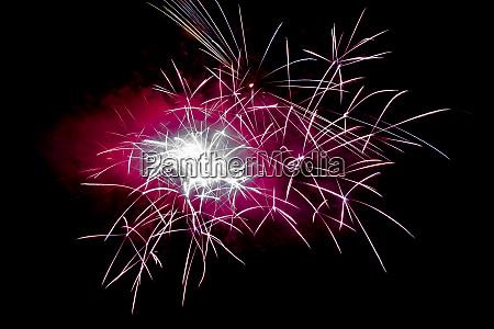 magenta horizontal sparkling fireworks background on