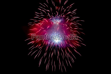 red sparkling fireworks background on night