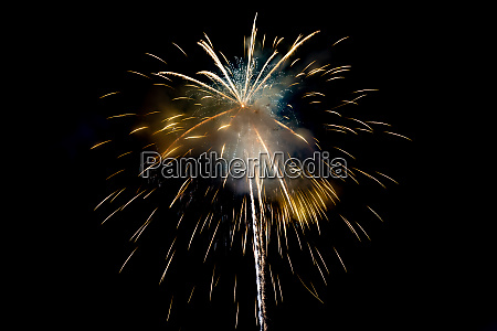 yellow sparkling fireworks background on night