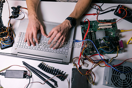 electronics technician working testing and