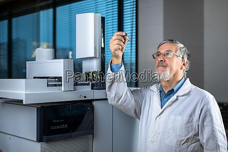 senior scientist in a chemistry lab