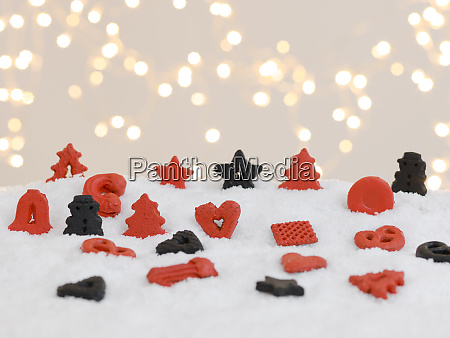 colourful christmas cookies on white snow