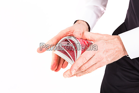 hands and a deck of cards