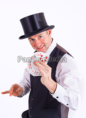magician shows a deck of cards