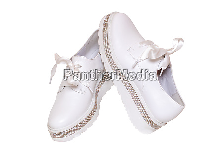 white sneaker isolated close up of