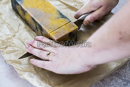 high angle close up person cutting