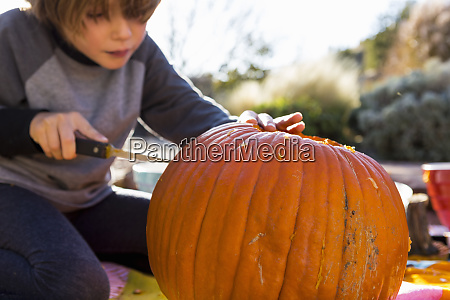 a six year old boy carving