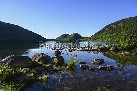 rocks in jordan pond by hills