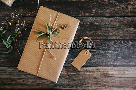present wrapped in brown paper and