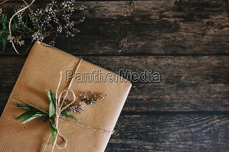 present wrapped in brown paper with