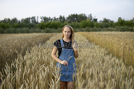 young woman wearing overall dress in