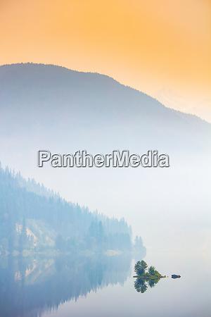 dense fog over a lake and