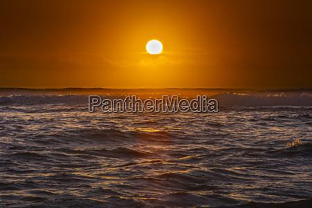bright golden sunrise over the pacific