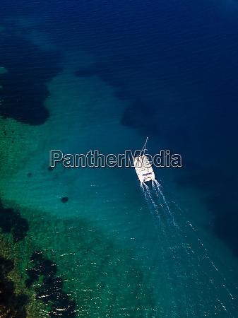 aerial view of catamaran sailing near