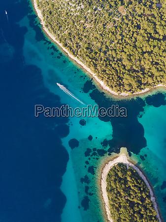 aerial view of boat sailing at