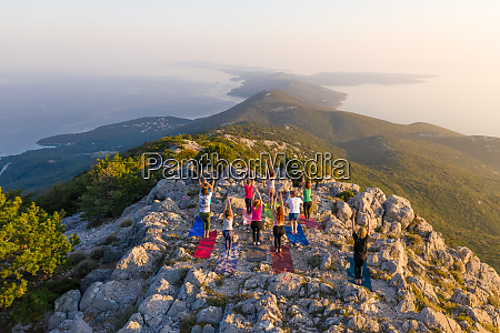aerial view of group practicing yoga