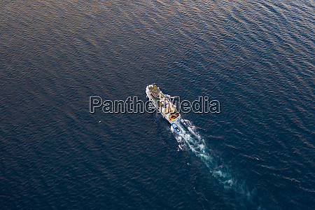 aerial view of fishing boat sailing