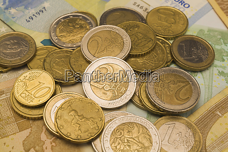 various euro coins on top of