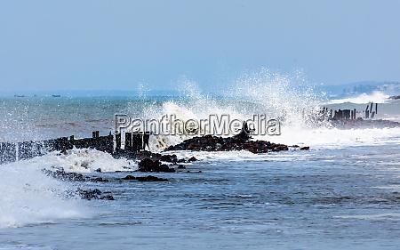 large ocean waves crashing and hitting