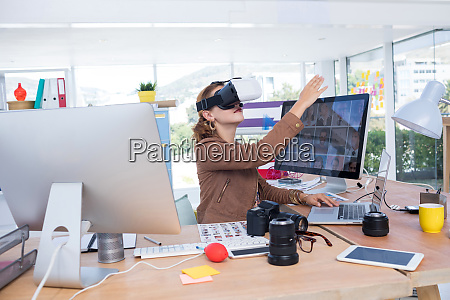 female executive working on laptop while