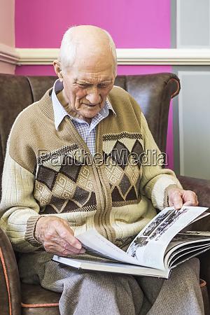 senior man sitting in a chair