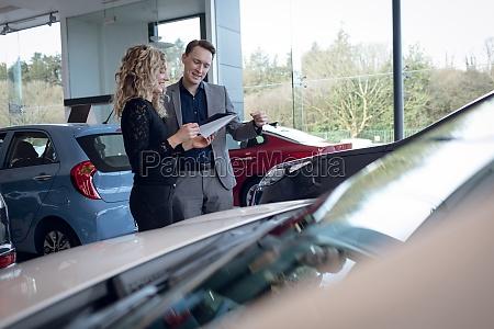 customer and salesman reading brochure