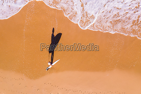 aerial view of a woman surfer