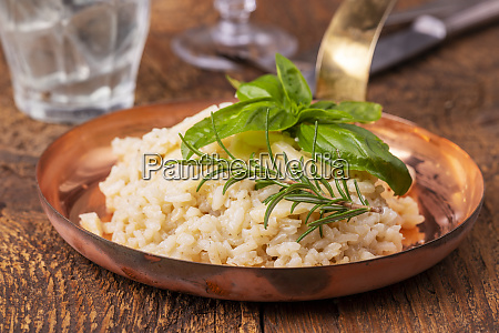 italian risotto with spices on wood