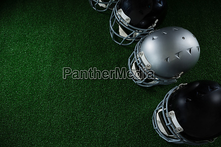 american football head gears arranged over