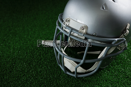 american football head gear over artificial