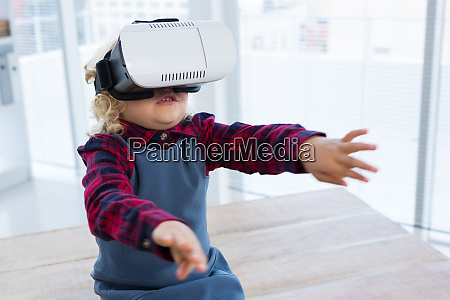 businesswoman looking through virtual reality simulator