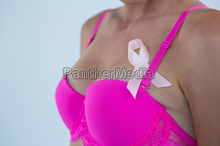 mid section of woman in pink