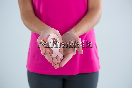 mid section of woman with pink